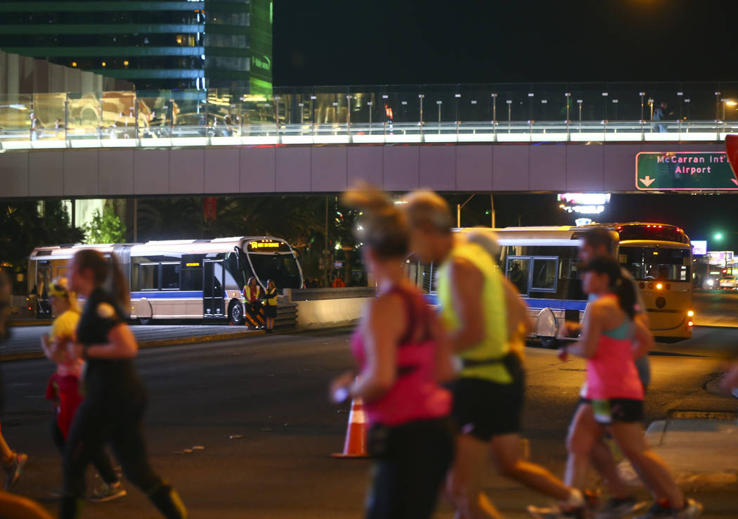 Busses block Tropicana Avenue at Las Vegas Boulevard as race participants pass by during the Rock 'n' Roll Marathon in Las Vegas on Sunday, Nov. 12, 2017. Chase Stevens Las Vegas Review-Journal @c ...