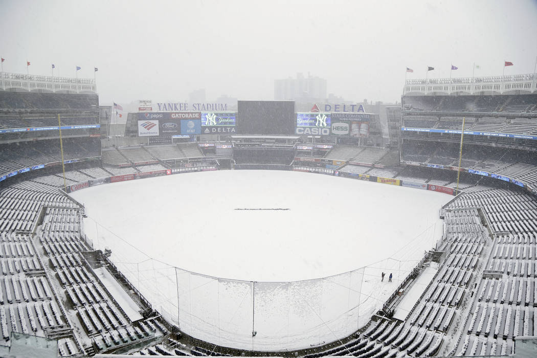 Snow covers the field before the scheduled New York Yankees' home opener game against the Tampa Bay Rays at Yankee Stadium, Monday, April 2, 2018, in New York. The game was postponed due to weathe ...