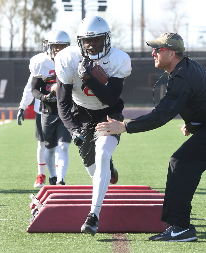 UNLV's running back coach Travis Burkett, keeps an eye on Charles Williams as Williams runs drills during a team practice on Tuesday, April 3, 2018, in Las Vegas. Bizuayehu Tesfaye/Las Vegas Revie ...