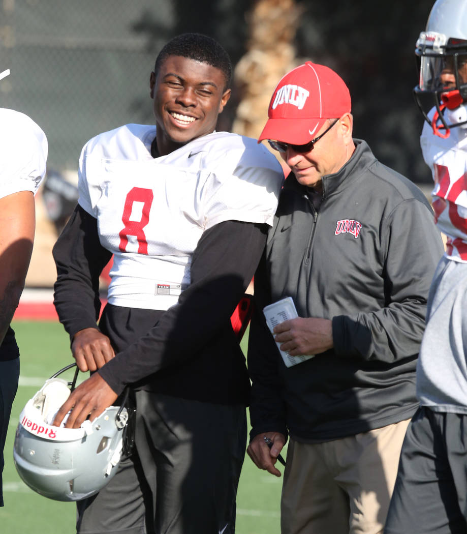 UNLV running back Charles Williams (8) chats with UNLV's Director of Athletic Training Kyle Wilson during a team practice on Tuesday, April 3, 2018, in Las Vegas. Bizuayehu Tesfaye/Las Vegas Revie ...