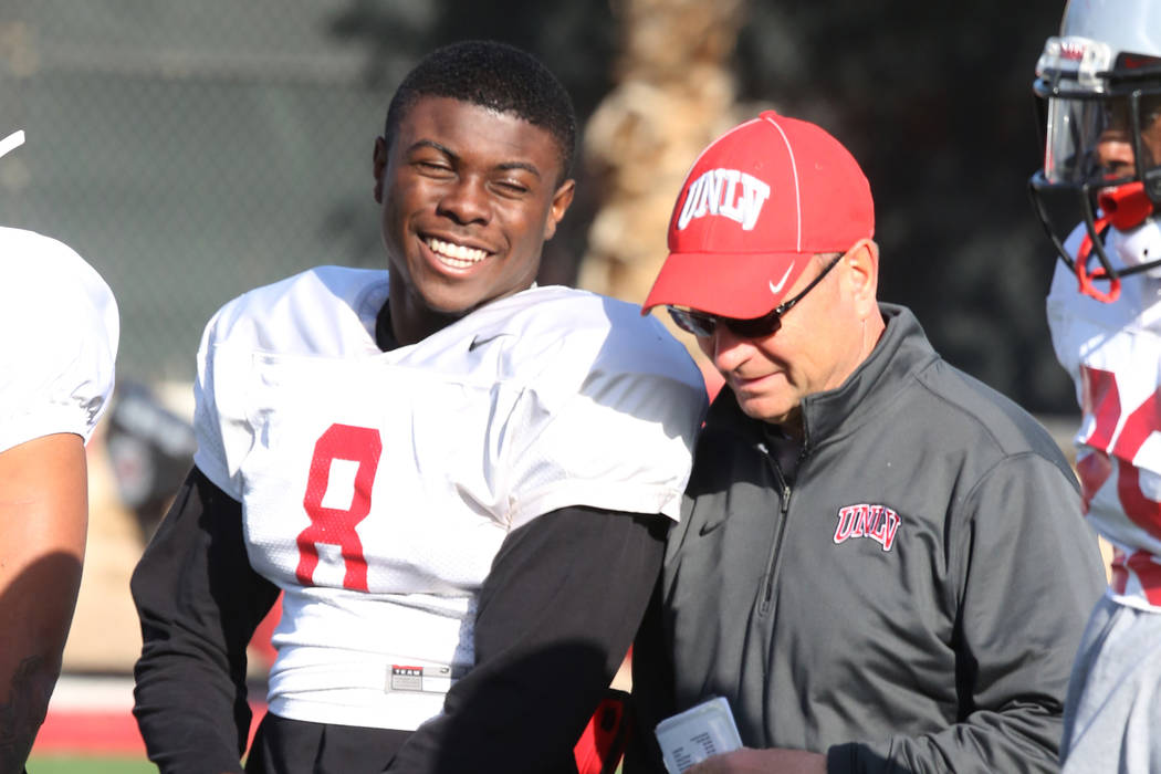 UNLV running back Charles Williams (8) chats with UNLV's Director of Athletic Training, Kyle Wilson, during team practice on Tuesday, April 3, 2018, in Las Vegas. Bizuayehu Tesfaye/Las Vegas Revie ...