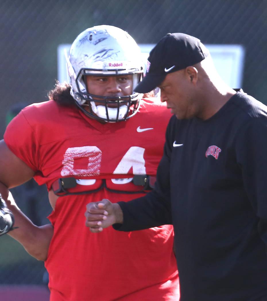 UNLV defensive tackle Kolo Uasike (94) listens to Tony Samuel, defensive line coach, during team practice on Monday, April 9, 2018, in Las Vegas. Bizuayehu Tesfaye/Las Vegas Review-Journal @bizute ...