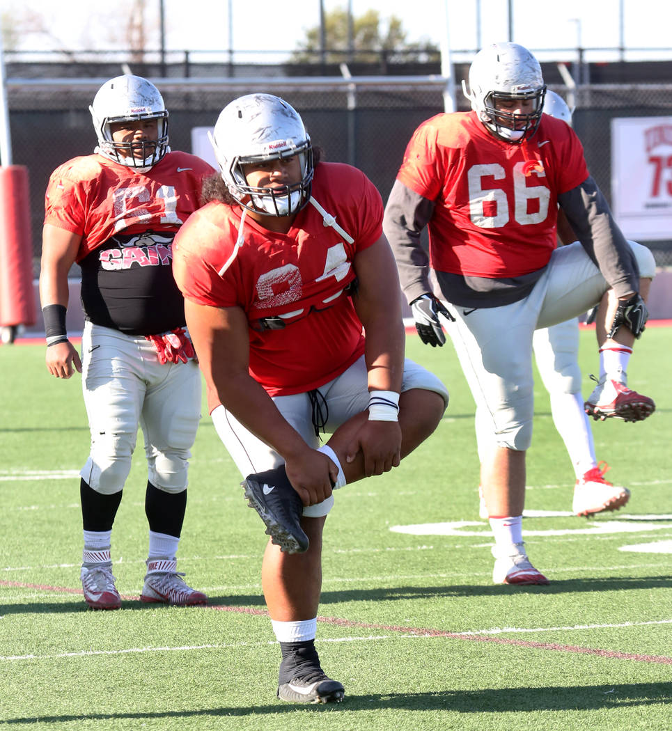 UNLV defensive tackle Kolo Uasike (94) stretches during team practice on Monday, April 9, 2018, in Las Vegas. Bizuayehu Tesfaye/Las Vegas Review-Journal @bizutesfaye