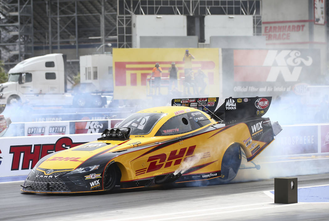 J.R. Todd, driver of the DHL Toyota Camry Funny Car, performs a burnout at The Strip at Las Vegas Motor Speedway ahead of the DENSO Spark Plugs NHRA Nationals in Las Vegas on Thursday, April 5, 20 ...