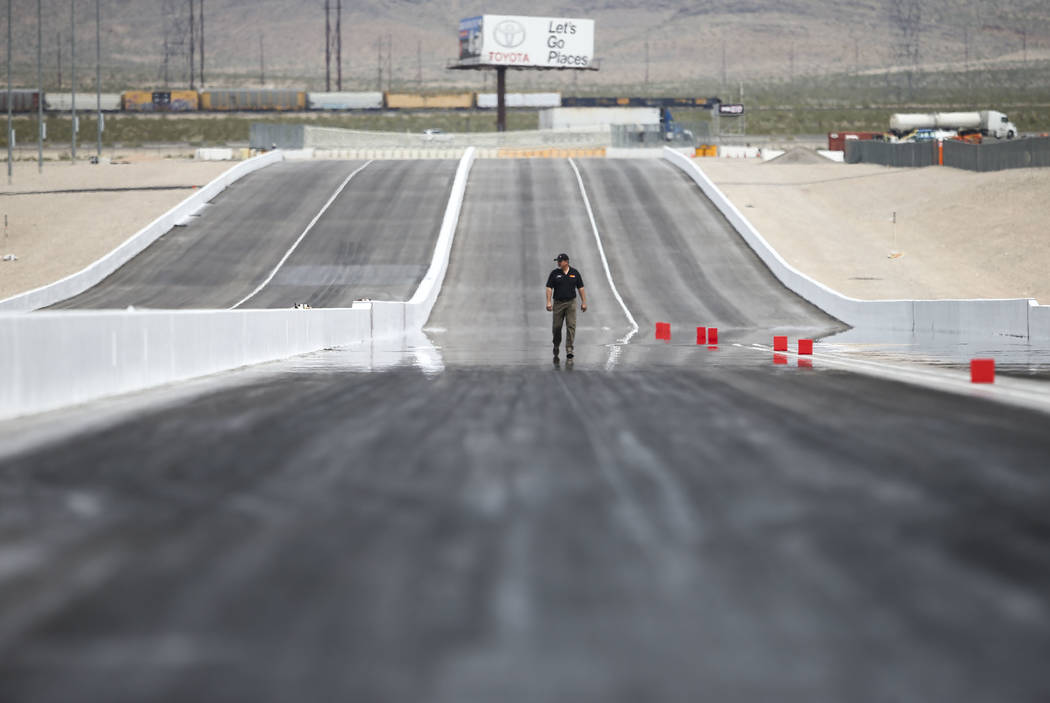 An official looks over the new four lane track at The Strip at Las Vegas Motor Speedway ahead of the DENSO Spark Plugs NHRA Nationals in Las Vegas on Thursday, April 5, 2018. Chase Stevens Las Veg ...