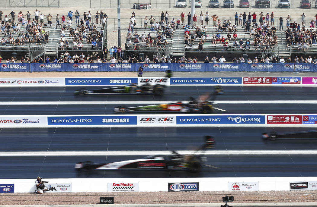 Top Fuel drivers compete on the new four-wide track during the first day of qualifying for the DENSO Spark Plugs NHRA Nationals at The Strip at Las Vegas Motor Speedway on Friday, April 6, 2018. C ...