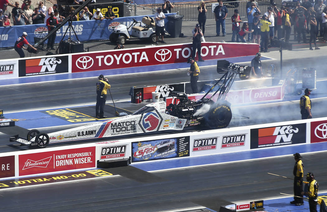 Top Fuel driver Antron Brown practices on the new four-wide track during the first day of qualifying for the DENSO Spark Plugs NHRA Nationals at The Strip at Las Vegas Motor Speedway on Friday, Ap ...