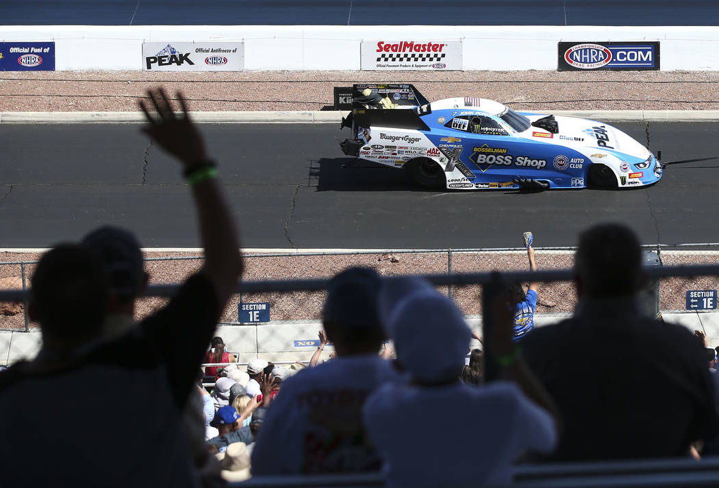 Race fans wave to Funny Car driver John Force during the first day of qualifying for the DENSO Spark Plugs NHRA Nationals at The Strip at Las Vegas Motor Speedway on Friday, April 6, 2018. Chase S ...