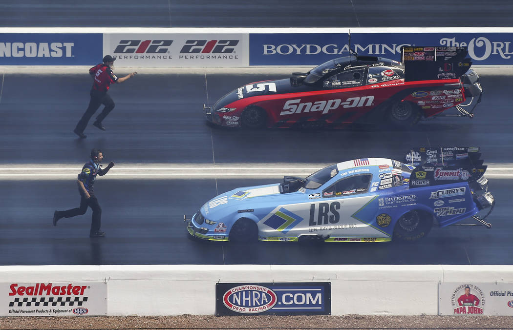 Funny Car drivers Cruz Pedregon, above, and Tim Wilkerson practice before competing in the first day of qualifying for the DENSO Spark Plugs NHRA Nationals at The Strip at Las Vegas Motor Speedway ...