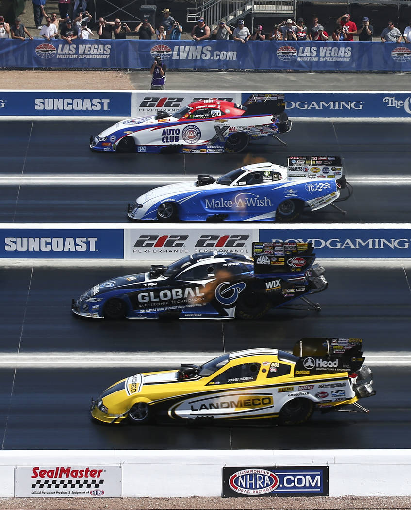 Funny Car drivers, from above, Robert Hight, Tommy Johnson Jr., Shawn Langdon and Jonnie Lindberg compete on the new four-wide track during the first day of qualifying for the DENSO Spark Plugs NH ...