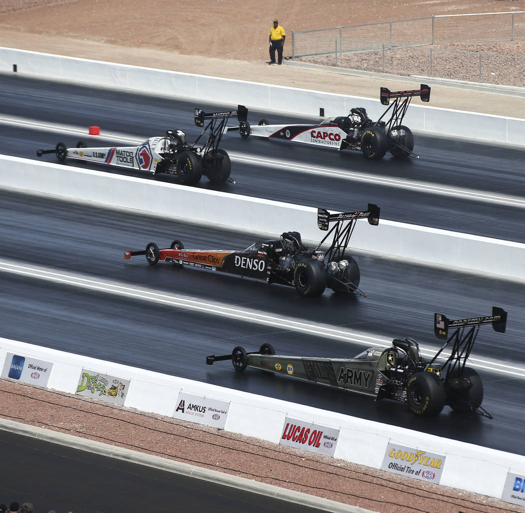 Top Fuel drivers, from above, Steve Torrence, Antron Brown, Clay Millican and Tony Schumacher compete on the new four-wide track during the first day of qualifying for the DENSO Spark Plugs NHRA N ...