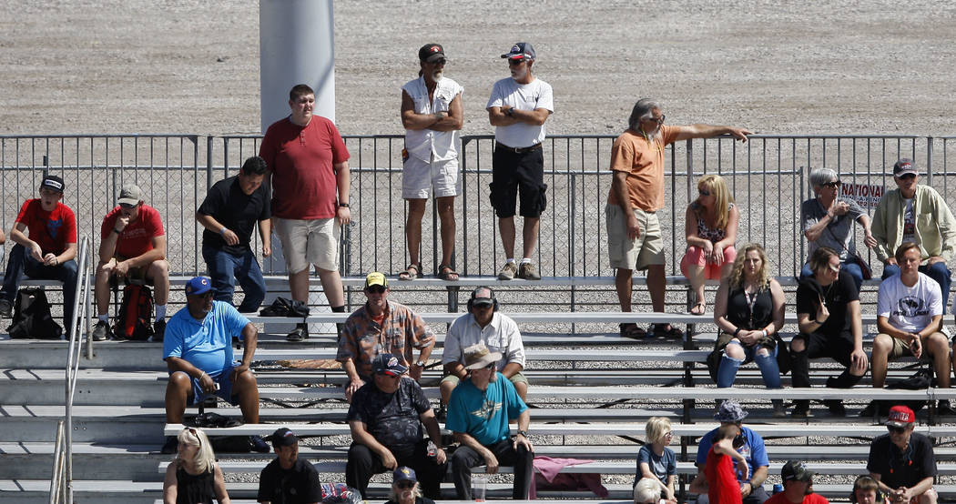 Fans take in the action during the first day of qualifying for the DENSO Spark Plugs NHRA Nationals at The Strip at Las Vegas Motor Speedway on Friday, April 6, 2018. Chase Stevens Las Vegas Revie ...