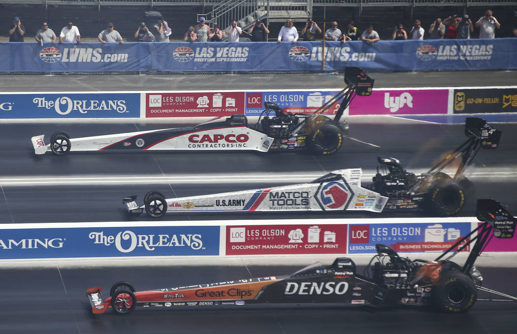 Top Fuel drivers, from above, Steve Torrence, Antron Brown and Clay Millican compete on the new four-wide track during the first day of qualifying for the DENSO Spark Plugs NHRA Nationals at The S ...