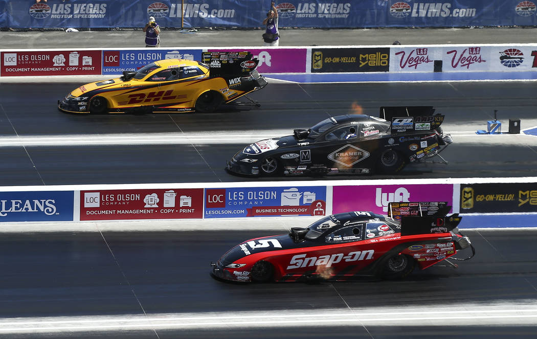 Funny Car drivers, from above, J.R. Todd, Del Worsham and  Cruz Pedregon compete during the first day of qualifying for the DENSO Spark Plugs NHRA Nationals at The Strip at Las Vegas Motor Speedwa ...