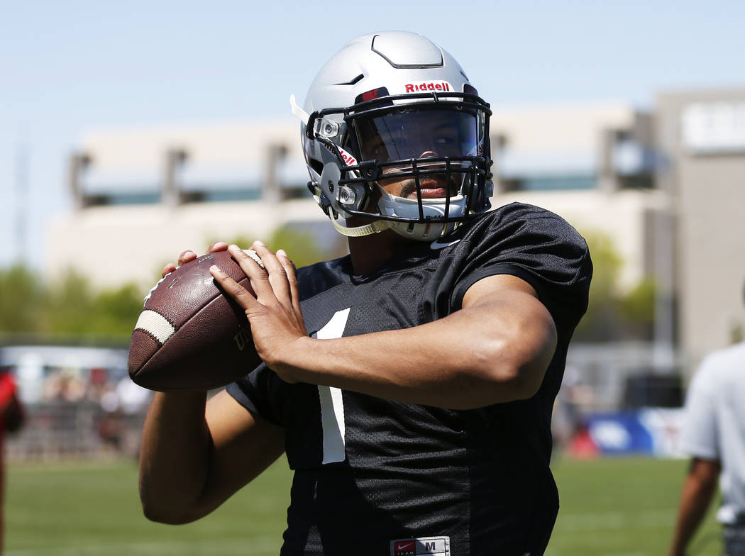 UNLV'S quarterback Armani Rogers (1) warms up before second quarter of UNLV's spring football game at the Peter Johann Memorial Field in Las Vegas on Saturday, April 14, 2018. Andrea Cornejo Las V ...