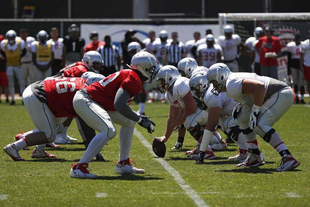 UNLV's football team prepare to snap the ball during first quarter of a spring game at the Peter Johann Memorial Field in Las Vegas on Saturday, April 14, 2018. Andrea Cornejo Las Vegas Review-Jou ...