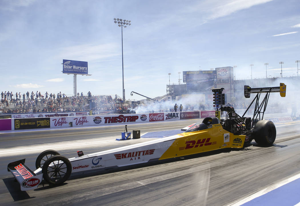Top Fuel driver Richie Crampton performs a burnout during the second day of qualifying for the DENSO Spark Plugs NHRA Nationals at The Strip at Las Vegas Motor Speedway in Las Vegas on Saturday, A ...