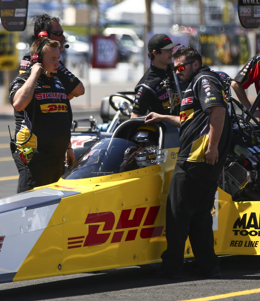 Top Fuel driver Richie Crampton, center, prepares for the second day of qualifying for the DENSO Spark Plugs NHRA Nationals at The Strip at Las Vegas Motor Speedway in Las Vegas on Saturday, April ...