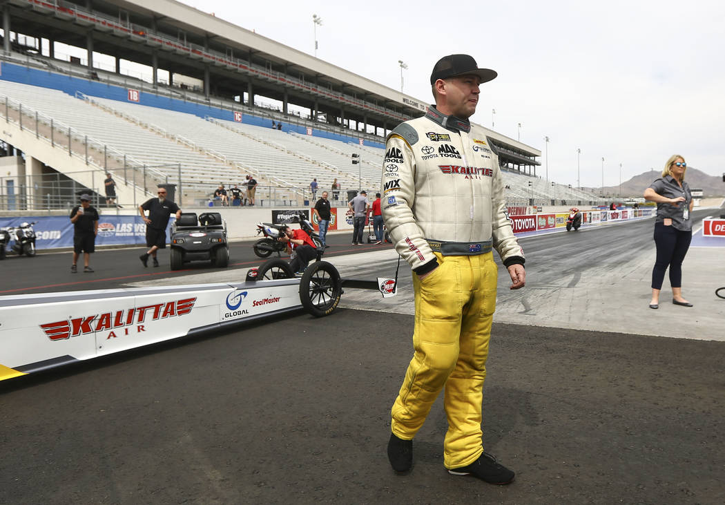 Richie Crampton, driver of the Kalitta Air dragster, prepares to perform a burnout at The Strip at Las Vegas Motor Speedway ahead of competing in the DENSO Spark Plugs NHRA Nationals in Las Vegas  ...