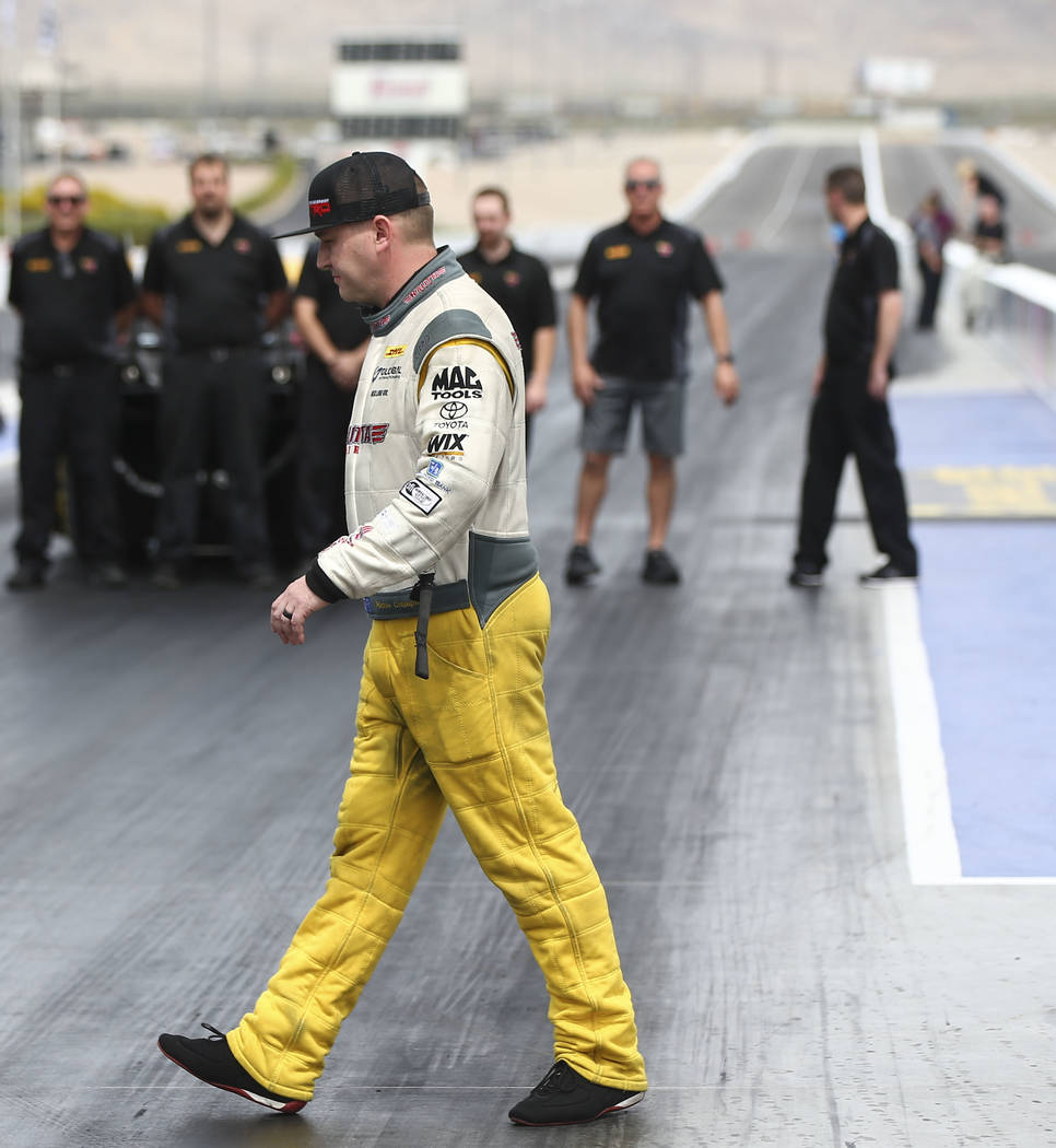 Richie Crampton, driver of the Kalitta Air dragster, prepares to perform a burnout at The Strip at Las Vegas Motor Speedway ahead of competing in the DENSO Spark Plugs NHRA Nationals slated for th ...