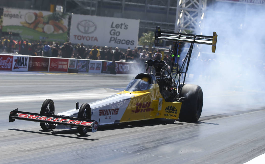 Top Fuel driver Richie Crampton competes during the second day of qualifying for the DENSO Spark Plugs NHRA Nationals at The Strip at Las Vegas Motor Speedway in Las Vegas on Saturday, April 7, 20 ...