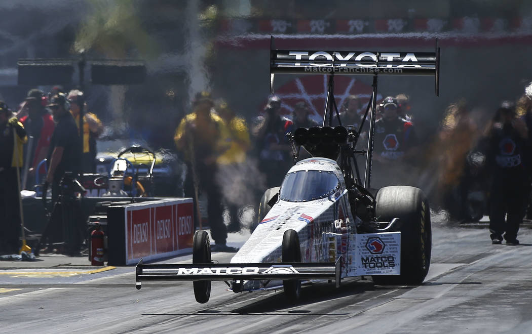 Top Fuel driver Antron Brown competes during the second day of qualifying for the DENSO Spark Plugs NHRA Nationals at The Strip at Las Vegas Motor Speedway in Las Vegas on Saturday, April 7, 2018. ...