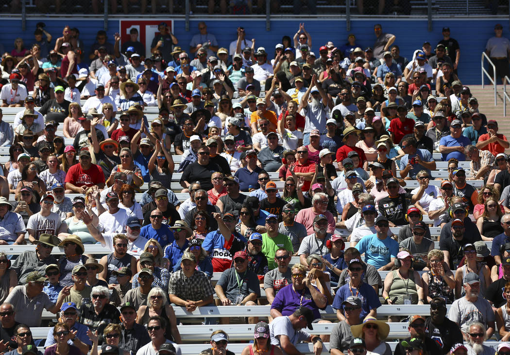 Fans cheer during the second day of qualifying for the DENSO Spark Plugs NHRA Nationals at The Strip at Las Vegas Motor Speedway in Las Vegas on Saturday, April 7, 2018. Chase Stevens Las Vegas Re ...
