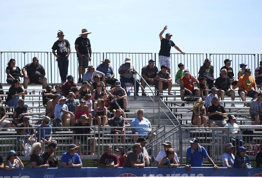 Fans look on during the second day of qualifying for the DENSO Spark Plugs NHRA Nationals at The Strip at Las Vegas Motor Speedway in Las Vegas on Saturday, April 7, 2018. Chase Stevens Las Vegas  ...