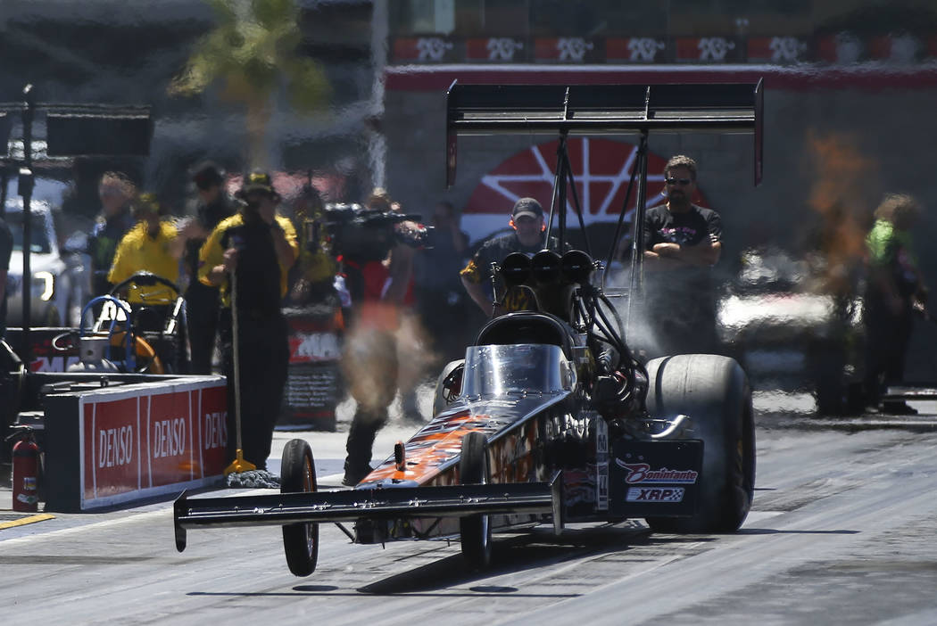 Top Fuel driver Terry Totten competes during the second day of qualifying for the DENSO Spark Plugs NHRA Nationals at The Strip at Las Vegas Motor Speedway in Las Vegas on Saturday, April 7, 2018. ...