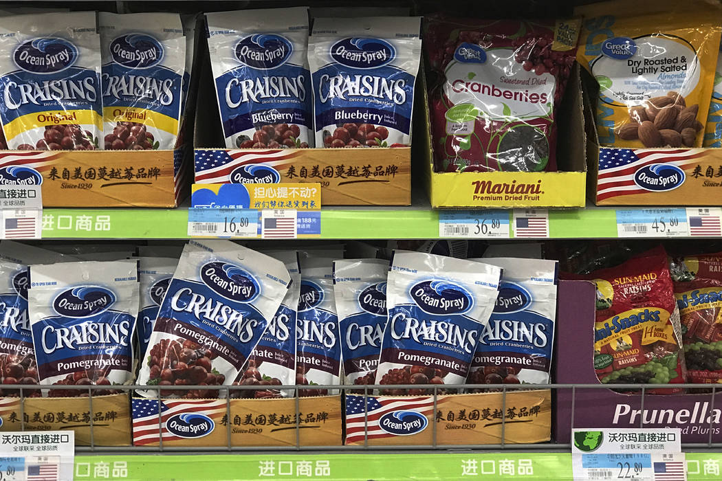 Imported raisins and nuts from the United States are displayed on sale at a supermarket in Beijing, Monday, April 2, 2018.  China raised import duties on a $3 billion list of U.S. pork, fruit and  ...