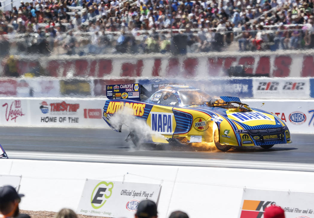 A Funny Car driven by Ron Capps takes off from the starting line during the first round of final eliminations on the final day of the DENSO Spark Plug NHRA Four-Wide Nationals at The Strip at Las  ...
