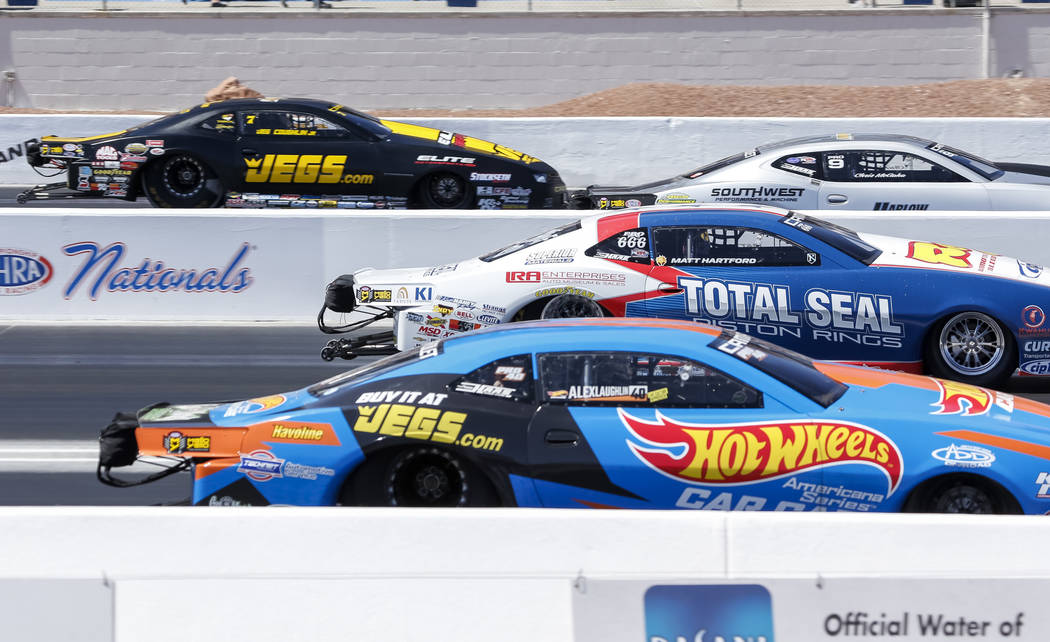 Pro Stock drivers, from top to bottom, Chris McGaha, Jed Coughlin Jr., Alex Laughlin and Matt Hartford take off from the starting line during the first round of final eliminations on the final day ...