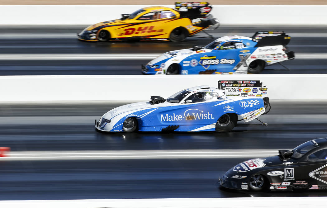 Funny Car drivers, from top to bottom, J.R. Todd, John Force, Tommy Johnson Jr. and Del Worsham, take off from the starting line during the second round of final eliminations on the final day of t ...