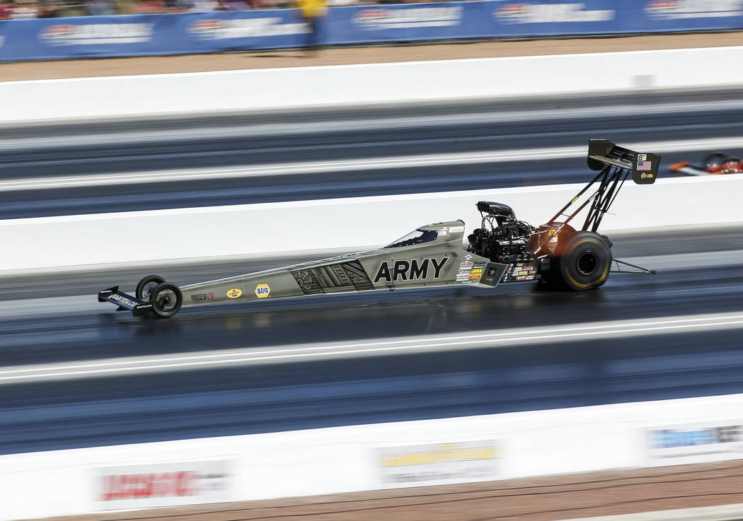 Top Fuel driver Tony Schumacher competes during the second round of final eliminations on the final day of the DENSO Spark Plug NHRA Four-Wide Nationals at The Strip at Las Vegas Motor Speedway in ...