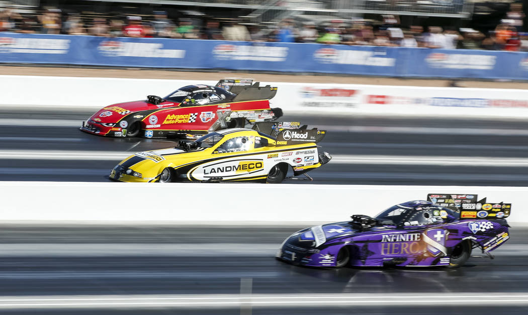 Funny Car drivers, from top to bottom, Courtney Force, Jonnie Lindberg, Jack Beckman and Gary Densham (not shown) compete during the second round of final eliminations on the final day of the DENS ...