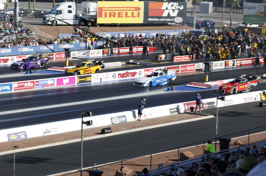 Funny Car drivers, from left to right, J.R. Todd, Tommy Johnson Jr., Jack Beckman, and Courtney Force, prepare compete in the final elimination race of the DENSO Spark Plug NHRA Four-Wide National ...