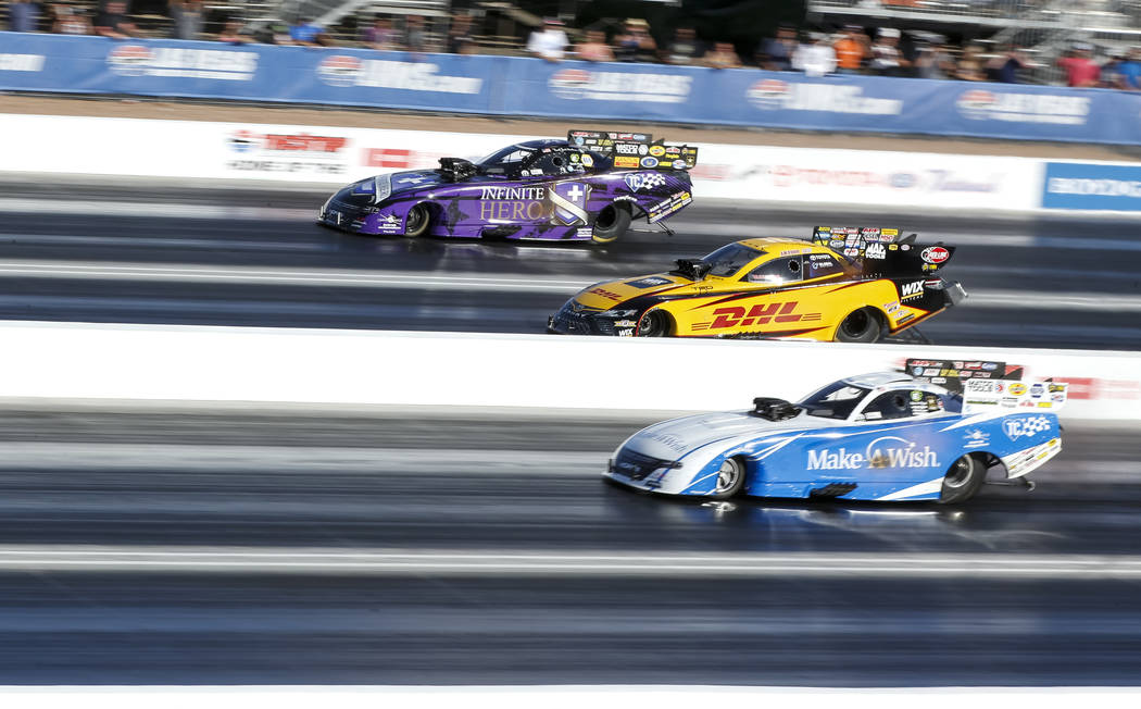 Funny Car drivers, from top to bottom, J.R. Todd, Tommy Johnson Jr., Jack Beckman, and Courtney Force (not show) compete in the final elimination race of the DENSO Spark Plug NHRA Four-Wide Nation ...