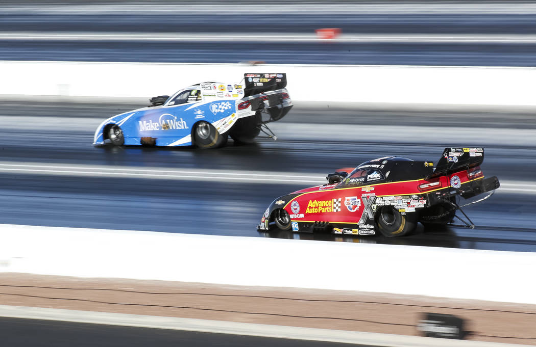 Funny Car drivers Jack Beckman, left, and Courtney Force compete in the final elimination race of the DENSO Spark Plug NHRA Four-Wide Nationals at The Strip at Las Vegas Motor Speedway in Las Vega ...