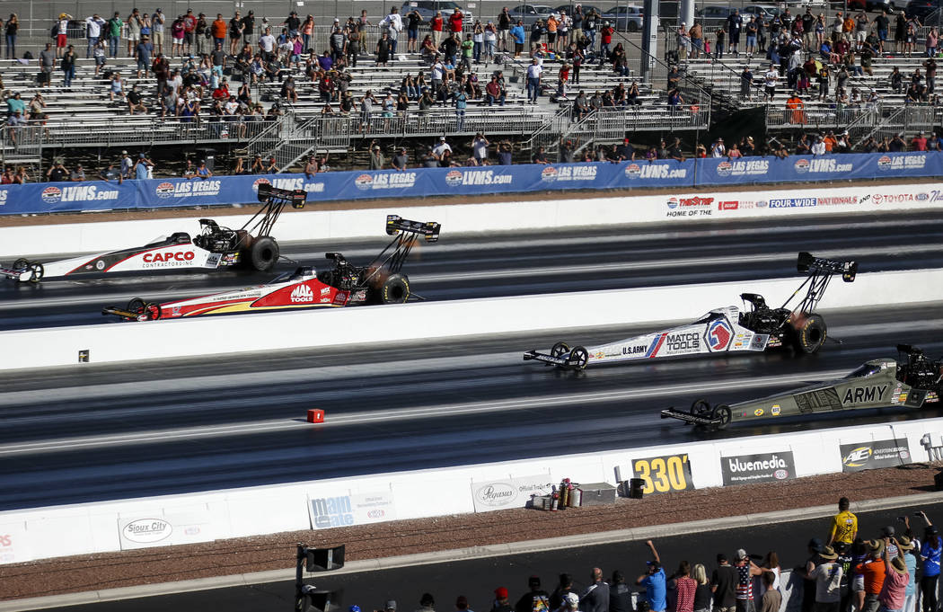 Top Fuel drivers, from top to bottom, Steve Torrence, Doug Kalitta, Antron Brown and Tony Schumacher compete in the final elimination race of the DENSO Spark Plug NHRA Four-Wide Nationals at The S ...
