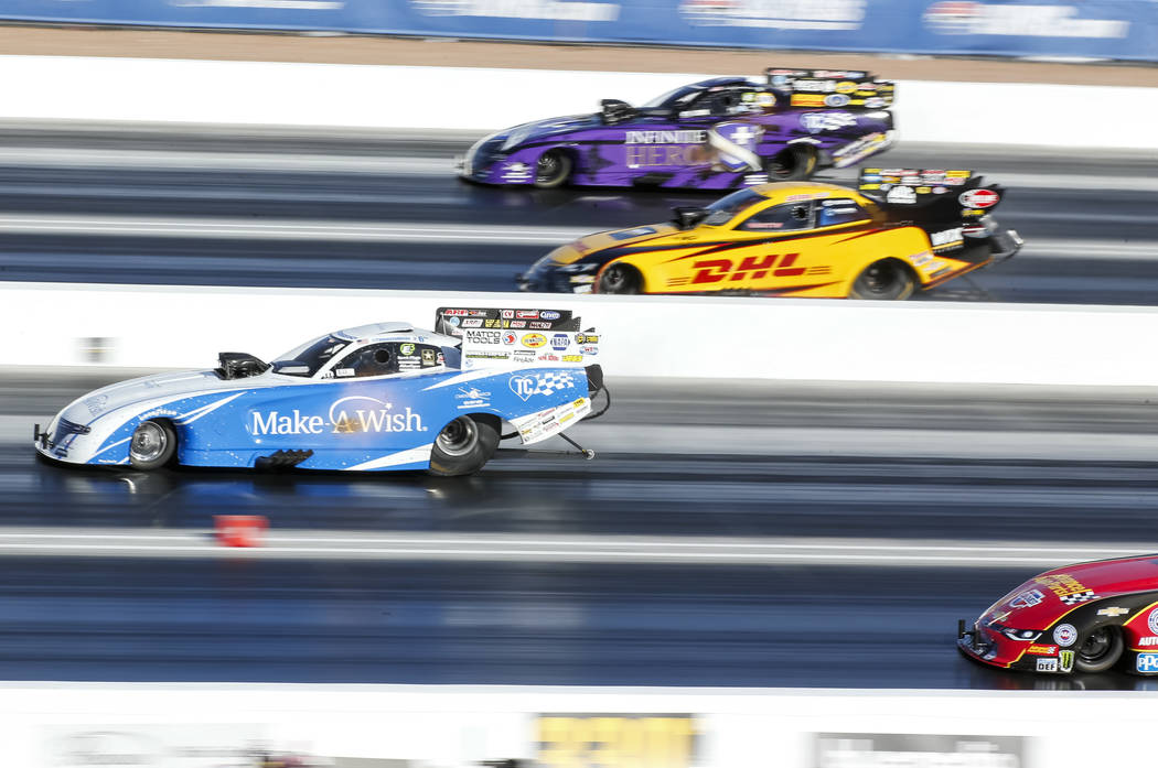 Funny Car drivers, from top to bottom, J.R. Todd, Tommy Johnson Jr., Jack Beckman, and Courtney Force compete in the final elimination race of the DENSO Spark Plug NHRA Four-Wide Nationals at The  ...