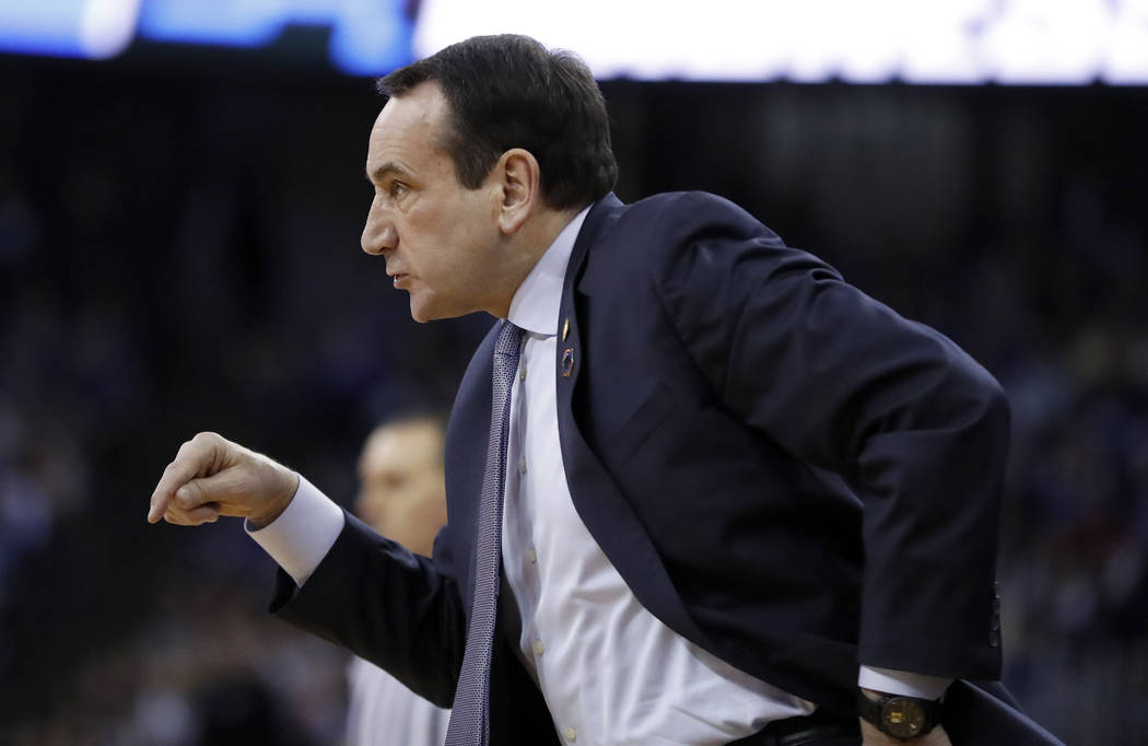 Duke head coach Mike Krzyzewski is seen on the sidelines during the first half of a regional final game against Kansas in the NCAA men's college basketball tournament Sunday, March 25, 2018, in Om ...