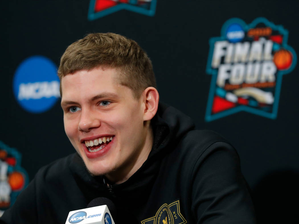 Michigan's Moritz Wagner answers questions during a news conference for the championship game of the Final Four NCAA college basketball tournament, Sunday, April 1, 2018, in San Antonio. (AP Photo ...