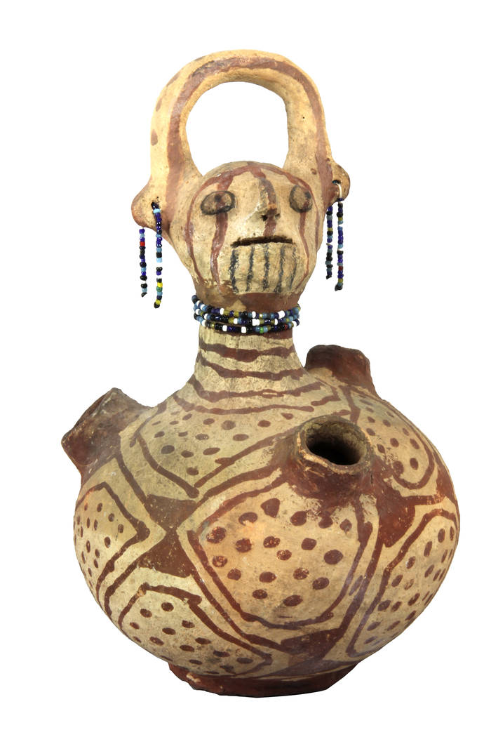35. The Indian tribes in southern Nevada included the Paiutes, Shoshones, and Mohaves. This effigy jar is a distinctive Mohave form, and dates from 1900.