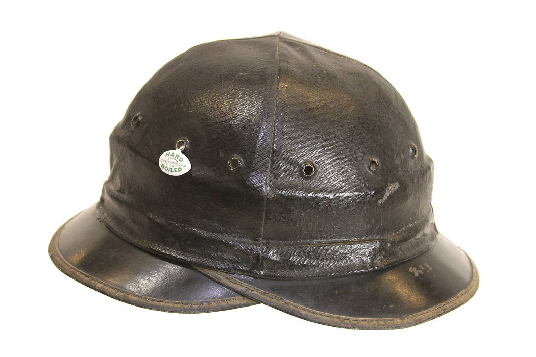 101. In 1919, the Hard-Boiled Hat was created by Bullard, a San Francisco based company, to protect miners and other workers from objects falling on their heads. Hats such as this one were used d ...