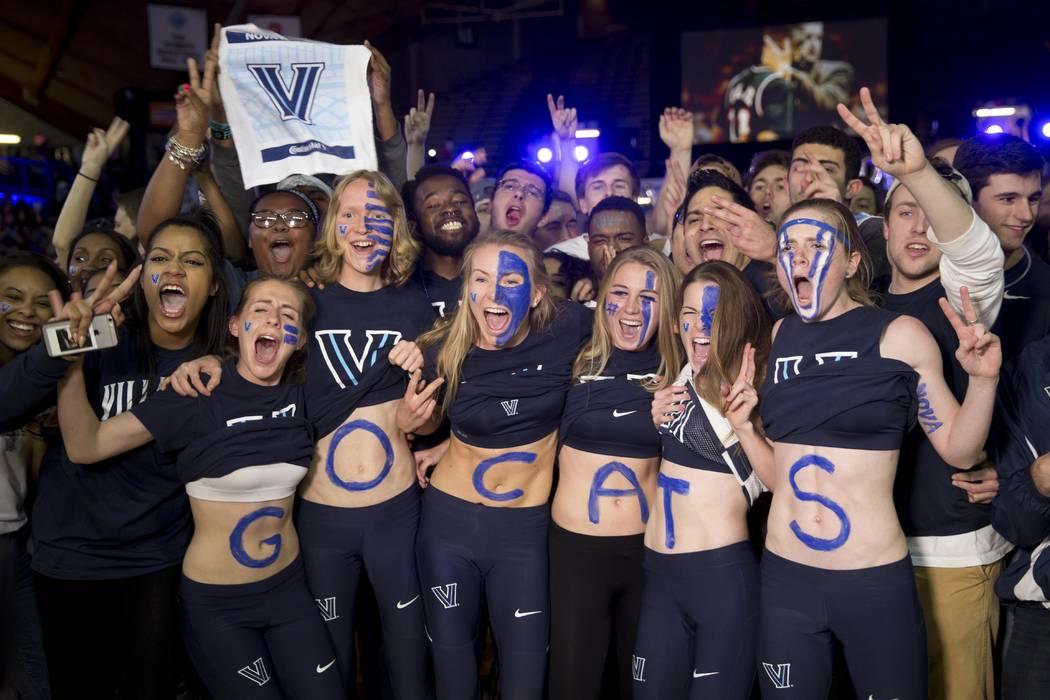 Villanova basketball fans cheer for cameras ahead of the broadcast of the national championship between Villanova and North Carolina, Monday, April 4, 2016, in Villanova, Pa. (AP Photo/Matt Rourke)