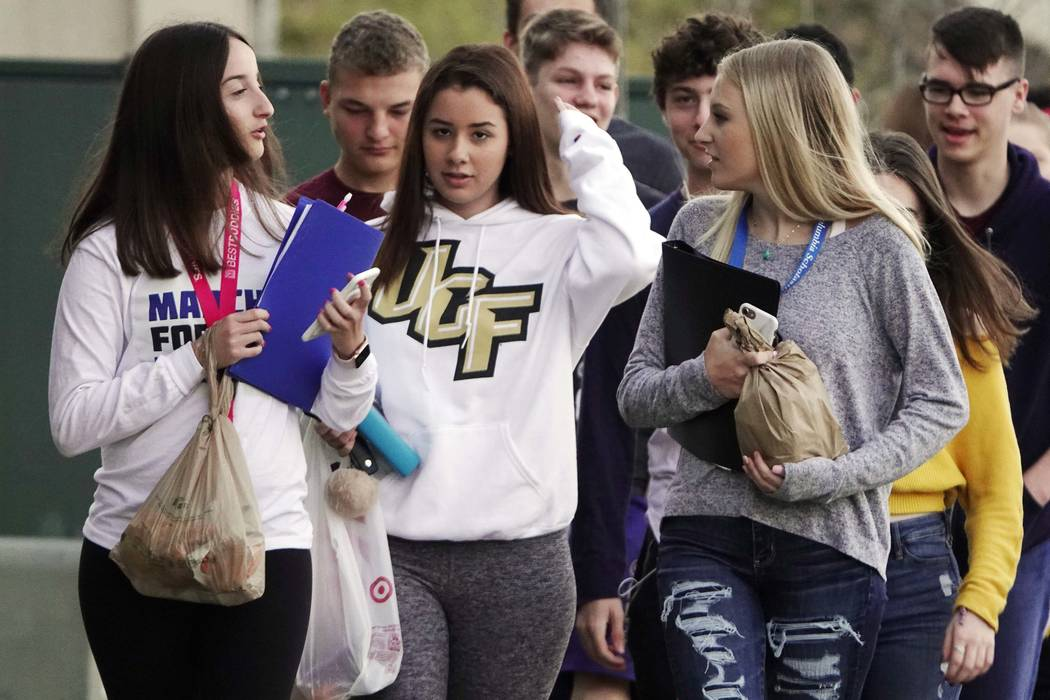 Marjory Stoneman Douglas High School students arrive back to school after spring break without backpacks, Monday, April 2, 2018, in Parkland, Fla. Students at the Florida high school where 17 peop ...