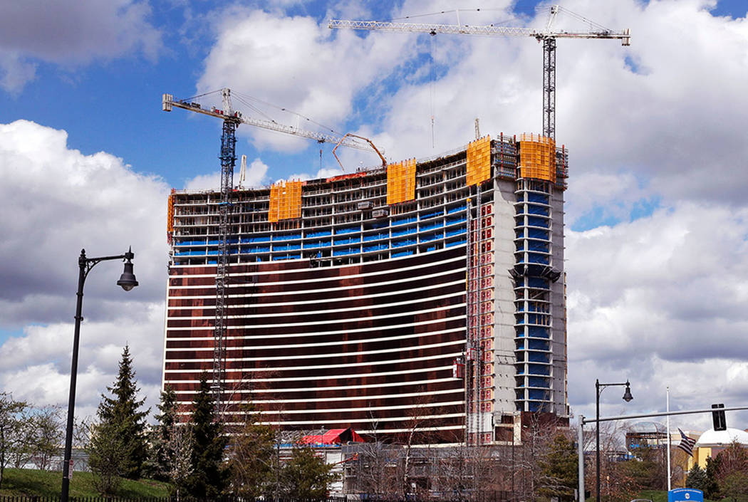 Construction cranes tower over the Wynn Resorts casino site in Everett, Mass., Thursday, April 26, 2018. (AP Photo/Charles Krupa)
