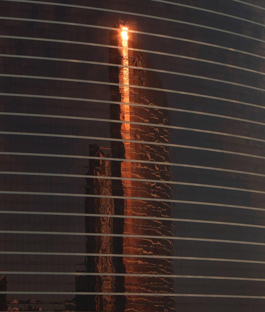 Wynn hotel-casino is reflected on the glass windows of Encore Las Vegas on Thursday, April 5, 2018. Bizuayehu Tesfaye/Las Vegas Review-Journal @bizutesfaye