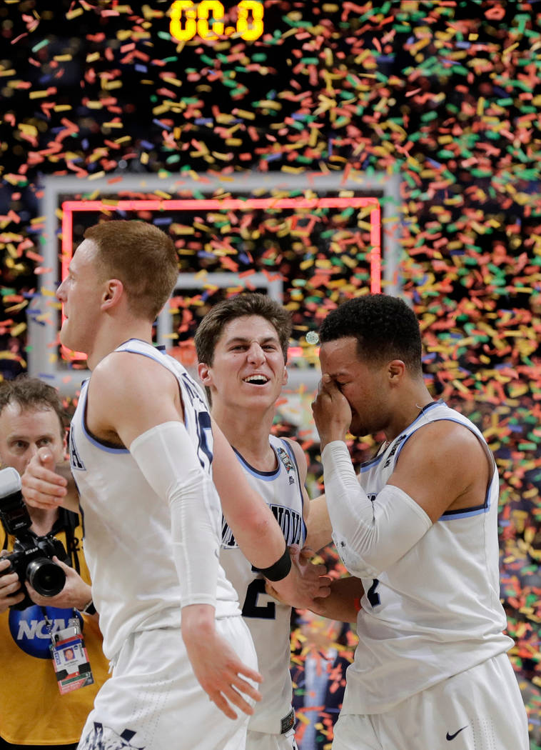 Villanova's Donte DiVincenzom left, Collin Gillespie and Jalen Brunson celebrate after the championship game of the Final Four NCAA college basketball tournament against Michigan, Monday, April 2, ...