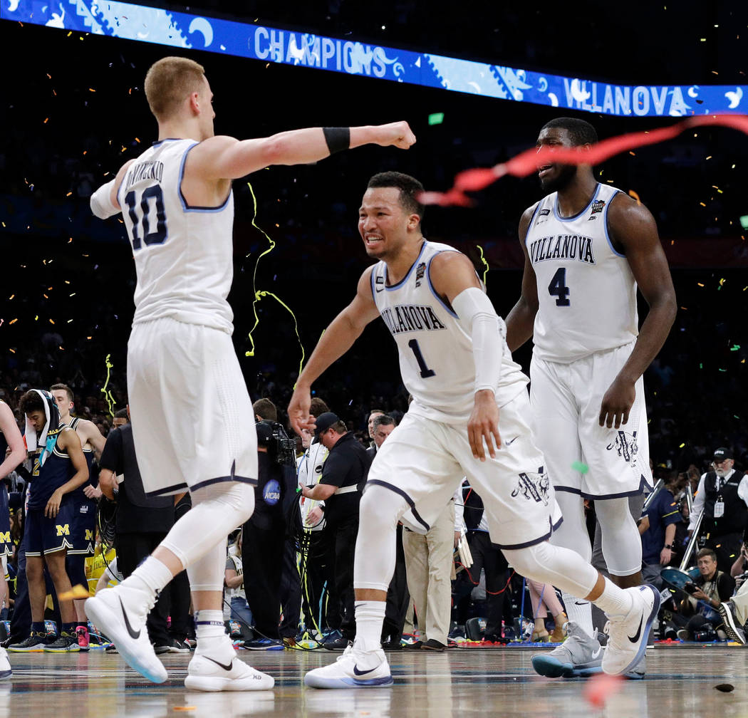 Villanova's Donte DiVincenzo (10) and Jalen Brunson (1) celerbate after the championship game of the Final Four NCAA college basketball tournament against Michigan, Monday, April 2, 2018, in San A ...